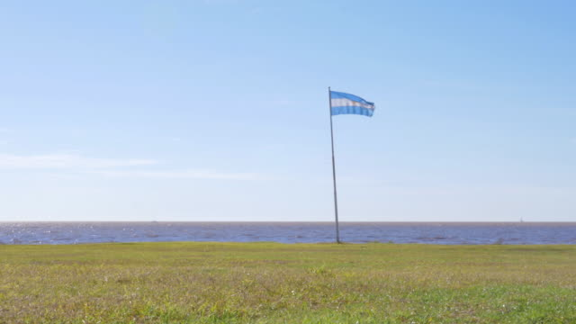 Argentinian flag waving in the coast video