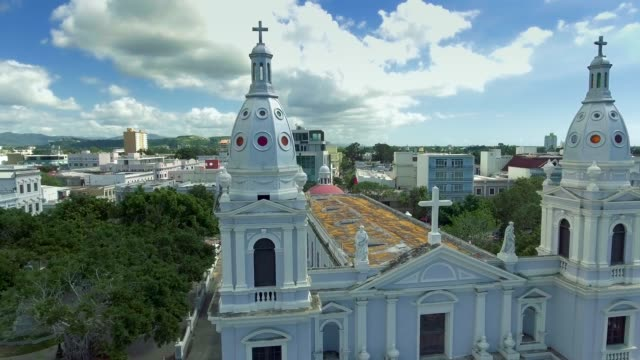 arial shot around historical church and the city of ponce in puerto rico - church architecture stock videos & royalty-free footage