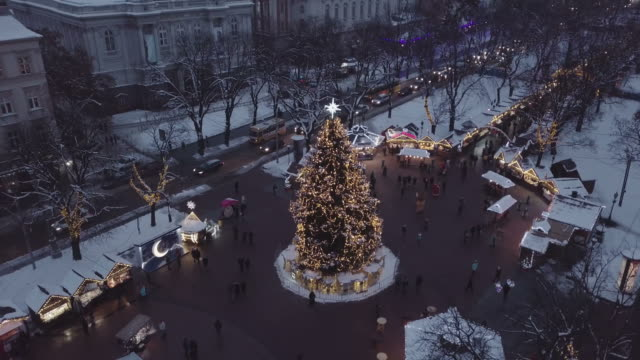 Lviv, Ukraine - December 2018. Arial shot. Lvov Opera house. Christmas tree. Christmas Fair. People are walking around the city center. Night time