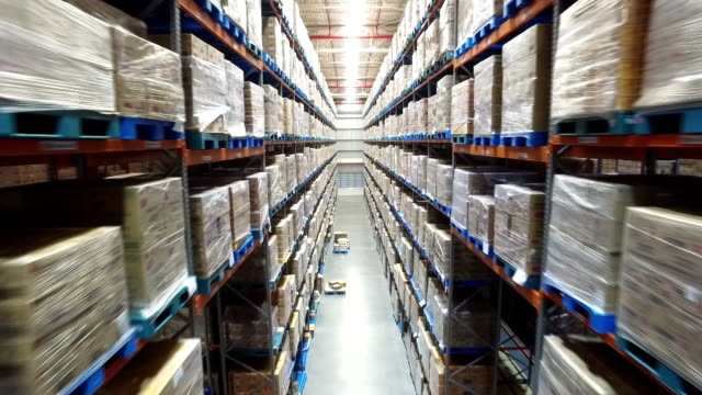 Arial view inside warehouse arial view between palettes with ordered goods and materials at warehouse forklift stock videos & royalty-free footage
