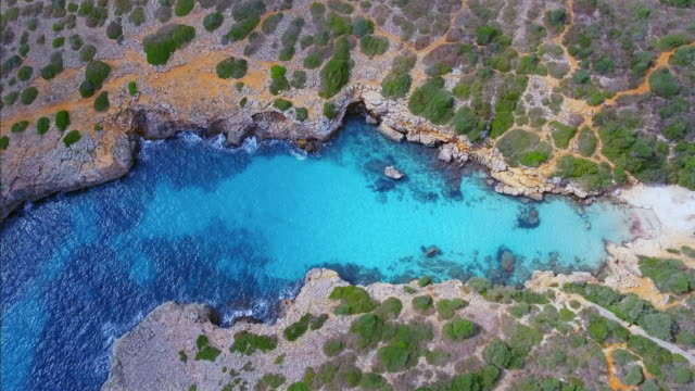 Arial View of Cala Petita on east coast on Spanish Balearic island of Majorca / Spain video