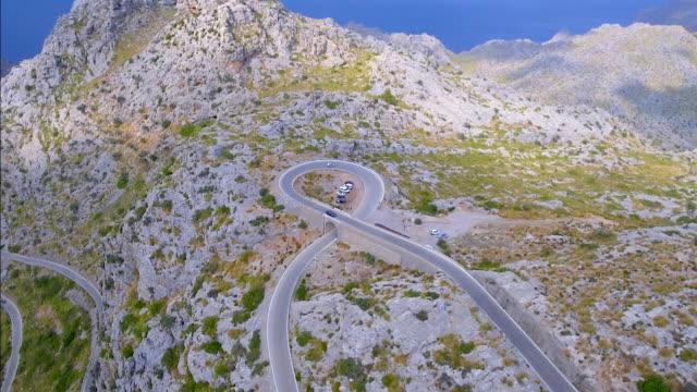 Arial View of mountain range with Hairpin turn near by Sa Calobra - Serra de Tramuntana / Majorca - Spain video
