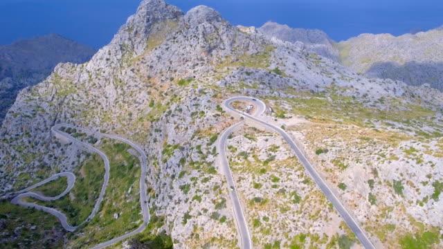 Arial View of mountain range with Hairpin turn nearby Sa Calobra - Sierra de Tramuntana / Majorca - Spain video