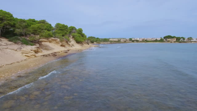 Arial View of S'Estanyol de Migjorn beach nearby Sa Rapita on southern coast on Spanish Balearic island of Majorca / Spain video