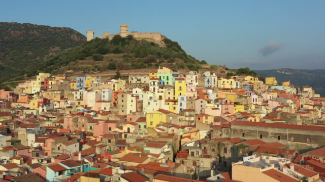 arial view of the beautiful village of bosa with colored houses. bosa is located in the north-west of sardinia, italy. - sardegna video stock e b–roll