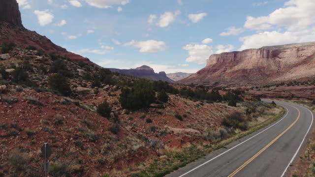 arid climate desert landscapes and mountain structures and the delores river on hwy 141 in colorado - masso video stock e b–roll