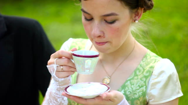 Aristocrats drink tea Beautiful girl in the lush dress drinks tea. Photoshoot in the Rococo style. Historical Portrait. rich interior. royalty stock videos & royalty-free footage