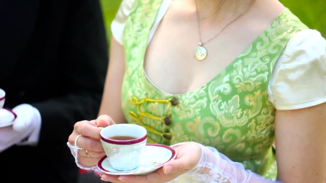 Aristocrats drink tea Beautiful girl in the lush dress drinks tea. Photoshoot in the Rococo style. Historical Portrait. rich interior. renaissance architecture stock videos & royalty-free footage