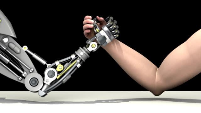 Arm wrestling. Man vs robot. Man wins. video
