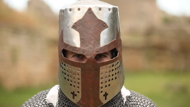armed knight with in helmet armed knight with in helmet looking in camera knight person stock videos & royalty-free footage