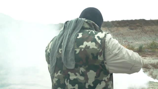 Armed Man Walking Through Smoke Grenade War video