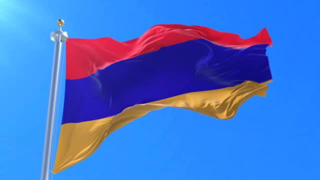 Armenia flag waving at wind in slow with blue sky, loop video