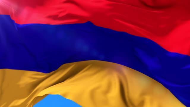 Armenian flag waving at wind in slow with blue sky, loop video