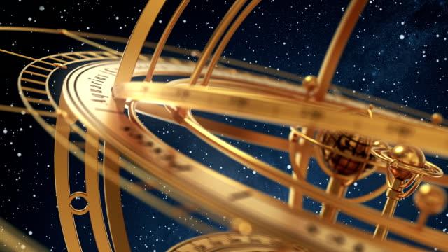 vídeos y material grabado en eventos de stock de esfera armilar en fondo de starburst. parte2. - constelación