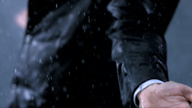 Arms Outstretched In The Rain (Super Slow Motion) HD1080p: Super Slow Motion shot of a businessman in a suit exposing to the raindrops with his arms outstretched. Close up shot of raindrops falling on his hand. drenched stock videos & royalty-free footage