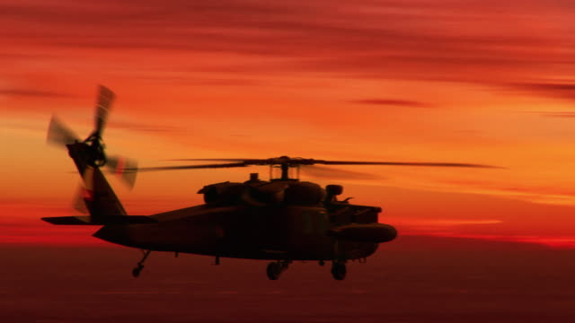Army Helicopter on sunset background Army Helicopter on sunset background helicopter stock videos & royalty-free footage