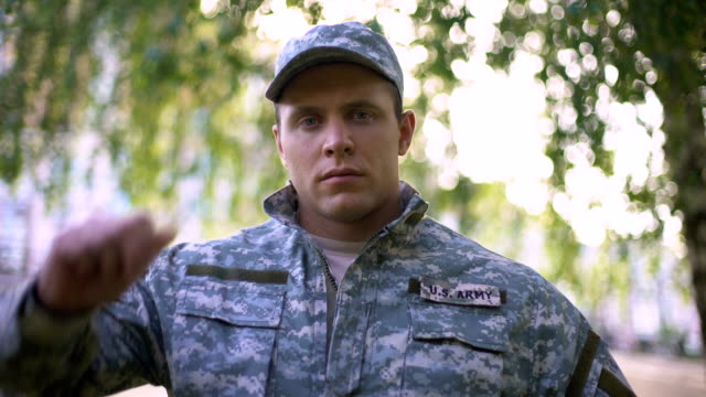 Army soldier in military uniform looking at camera, professional serviceman Army soldier in military uniform looking at camera, professional serviceman veteran stock videos & royalty-free footage