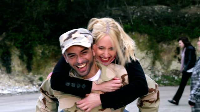 Army soldier returning home Army soldier returning home to the embrace of his wife homecoming stock videos & royalty-free footage