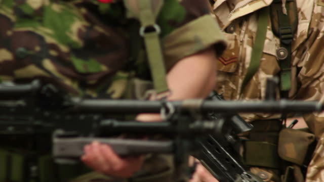Army Soldiers walking into focus - HD & PAL video