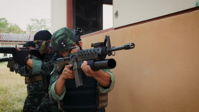 Army soldiers with guns during the military operation in the abandoned building, War concept