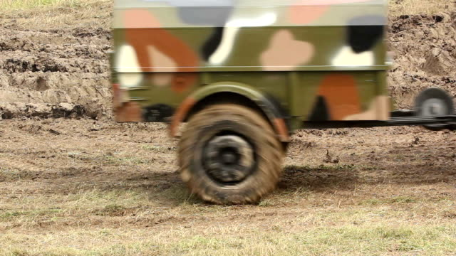 army truck driving in a field - caravan stock videos & royalty-free footage