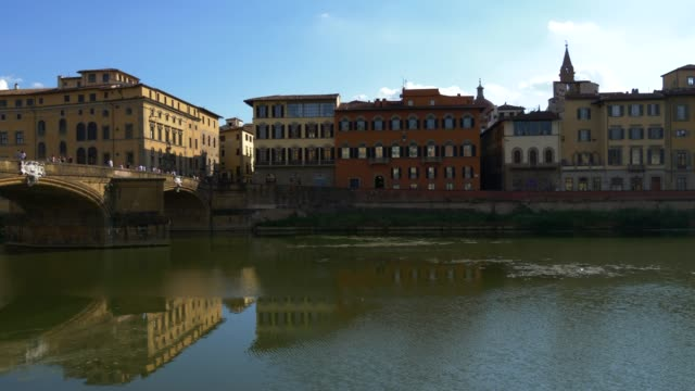 Arno river with old buildings in Florence, Italy