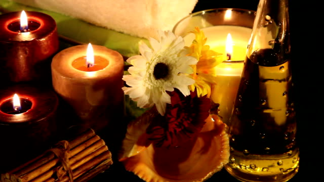 Aroma Therapy Essential Oil Bottles, towels, candle and flower for healthy spa treatment massage oil stock videos & royalty-free footage
