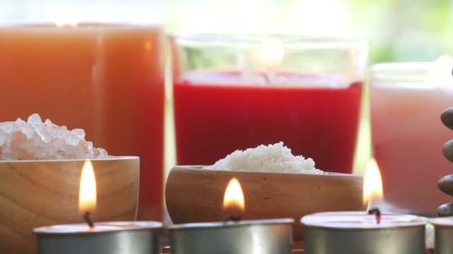 Aromatherapy massage setting with candle. Aromatherapy massage setting with candle. massage oil stock videos & royalty-free footage