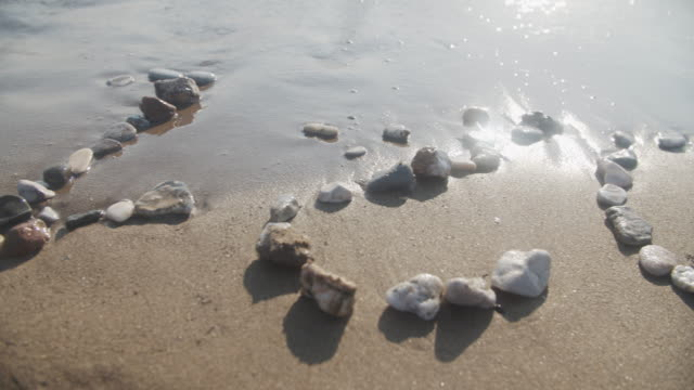 2021 arranged with stones on the beach