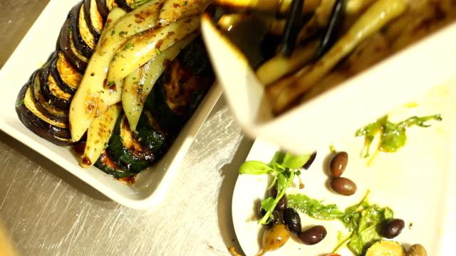 Arranging grilled vegetables on plate video