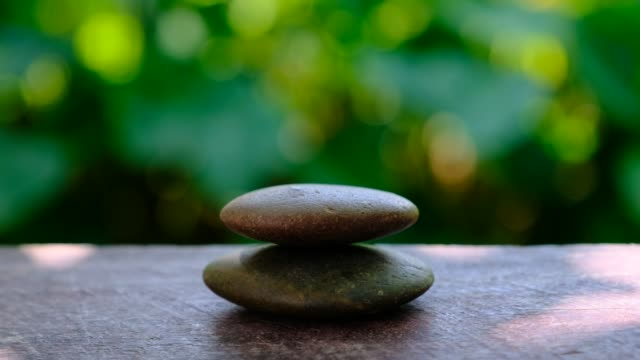 Arranging the stones into the tower, symbol of the pyramid and zen stone, balance the stone stacking Arranging the stones into the tower, symbol of the pyramid and zen stone, balance the stone stacking yin yang symbol stock videos & royalty-free footage