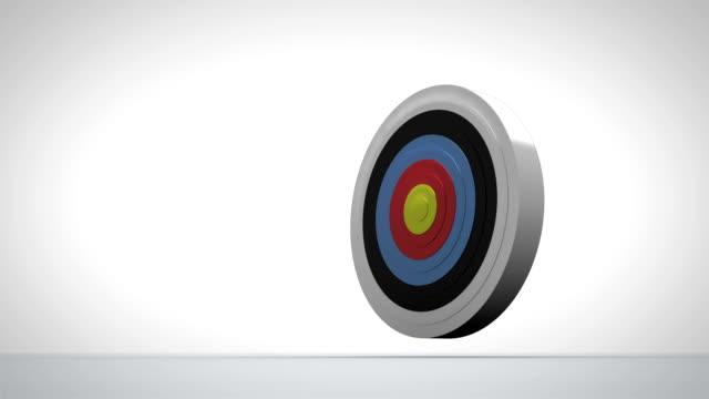 Arrow flying towards dart board and hitting target video