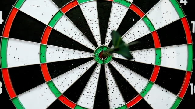 Arrow hits target bullseye in darts video