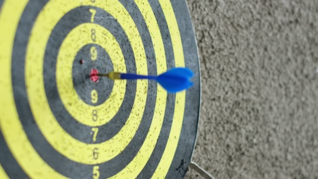 arrow in center of target board hang on wall video