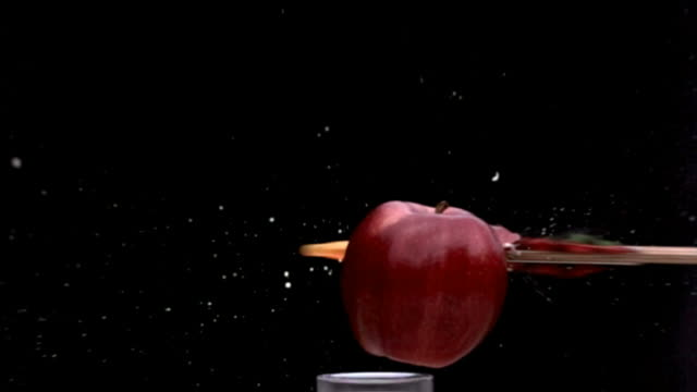 Arrow through apple, slow motion Shooting an apple with an arrow, 2000 frames per second. apple fruit stock videos & royalty-free footage