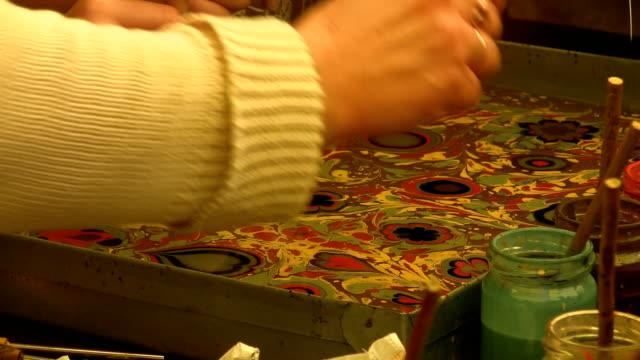 Art students practicing ebru video
