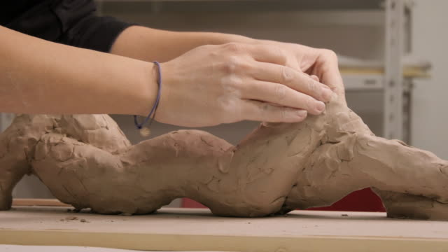 Art Studio. Young Woman Making a Sculpture. video
