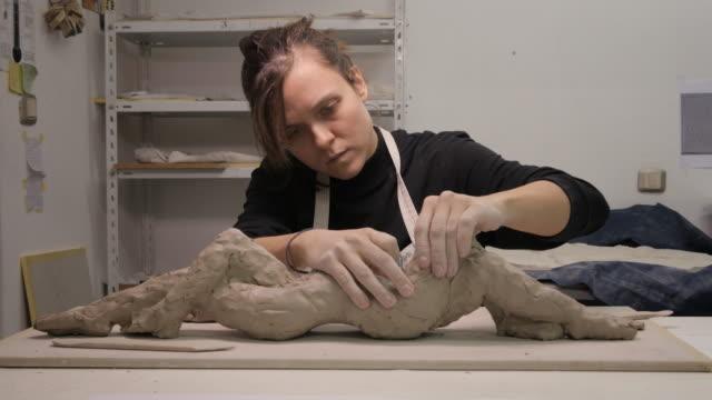 Art Studio. Young Woman Making a Sculpture. video