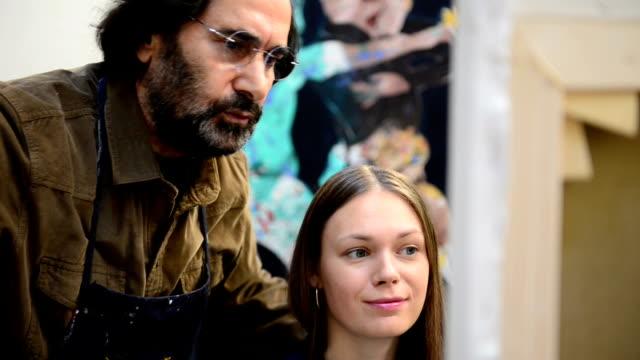 Art teacher and student in the art studio video