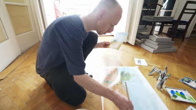 Art teacher working on new painting. video