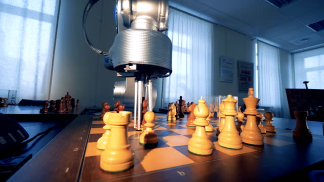 artificial intelligence concept. innovative modern robotic arm playing chess with a man. 4k. - ai stock videos & royalty-free footage