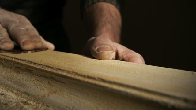artisan hands restoring wooden window - drewno tworzywo filmów i materiałów b-roll