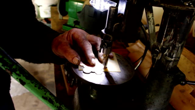 Artisan workshop that builds a belt for a Tyrolean tracht video