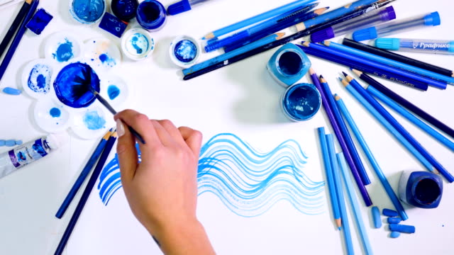 Artist drawing blue background. Stylish designer desk from above. video