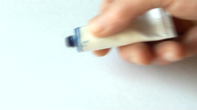 artist pushes the paint from the tube video