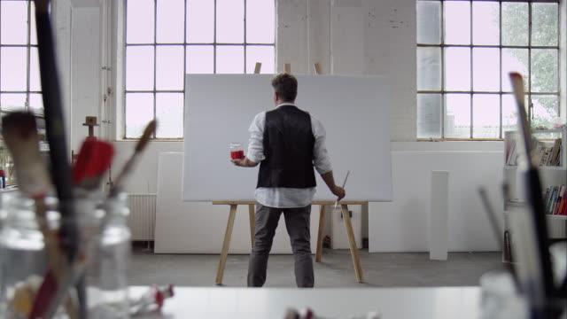 Artist starts painting on canvas video