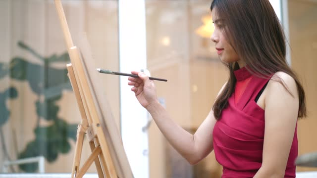Artist woman enjoy painting