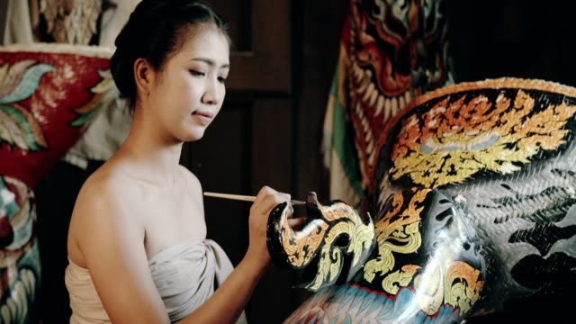Artist women painting ghost mask