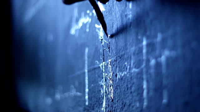 Artist writing with ink pen on the wall video