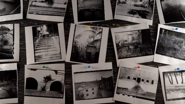 stockvideo's en b-roll-footage met artistieke foto's in donkere kamer - polaroid
